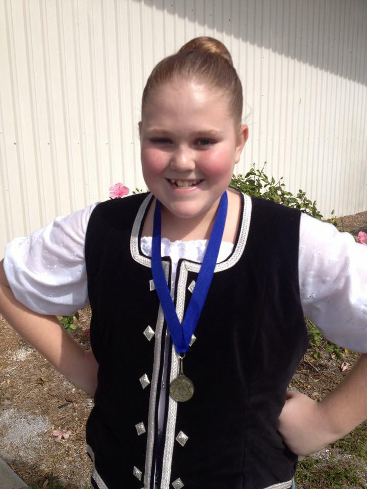 Dancer with medal